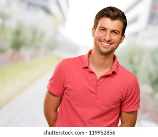 Portrait of young man smiling, outdoor