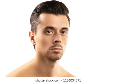 Portrait of young man with a smooth skin isolated on white background