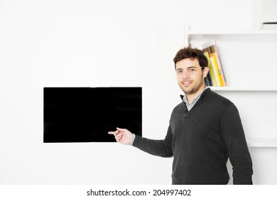 Portrait of a young man start up pointing to a screen