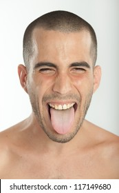 Portrait of a young man sticking his tongue out