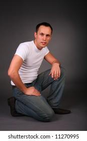 portrait of young man in studio on dark background