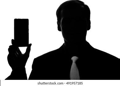 Portrait young man in suit and tie point on smart phone, tablet in hand - silhouette