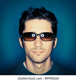 Portrait of a young man with sunglasses.