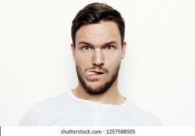 portrait of a young  man surprised face expression over white background