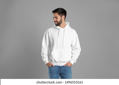 Portrait of young man in sweater on grey background. Mock up for design