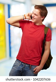 portrait of young man talking on mobile indoor