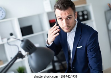 Portrait of a young man talking on the phone.