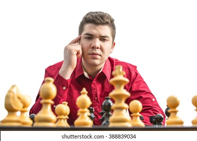 Portrait of a young man thinking during a chess match.