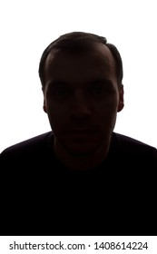 Portrait of a young man, unshaven, front view - dark isolated silhouette