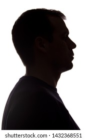 Portrait of a young man, unshaven, side view - dark isolated silhouette