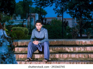 Portrait of young man urban background with modern haircut