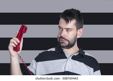 Portrait of young man using telephone