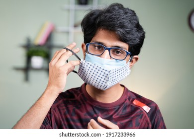 Portrait Young man wearing double or two face mask to protect from coronavirus or covid-19 outbreak - concept of safety, healthcare, medical and hygiene.