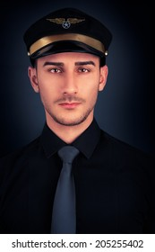 Portrait - Young man wearing  hat, black shirt and tie on black background