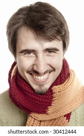 Portrait of a young man wearing a scarf and green pullover