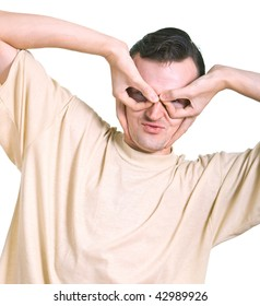 Portrait of the young man which hands simulates a mask of the Batman. Isolation on white background.