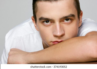 portrait of a young man in a white t-shirt close-up