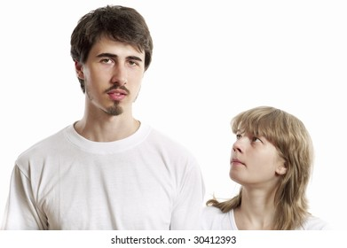 Portrait of young man and woman against white background