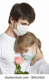 Portrait of young man and woman wearing masks  in tight embrace