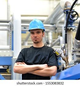 portrait of a young mechanical workmen in a industrial plant
