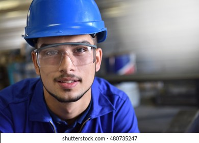 Portrait of young metalwork trainee in workshop