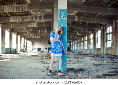 portrait of a young miserable sleeping girl walk inside abandoned interior. Concept of crazy zombie loneliness woman. Idea of sleepwalker