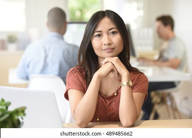 Portrait of young mixed-race woman working in office