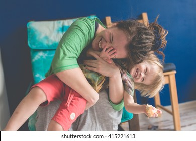 portrait of  young mother with her baby at home, living a real interior , Mom and son embrace, toning