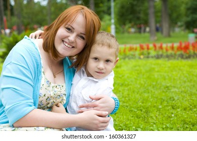 Portrait of young mother and her four-year-old son outdoors