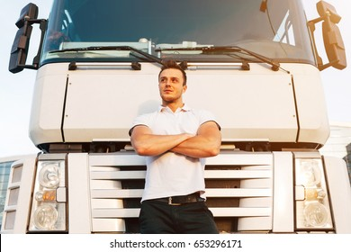 Portrait of Young Muscular Man Driver in White T-shirt Standing Near Truck, Trucker Concept