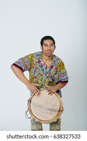 Portrait of young musician with Djembe drum
