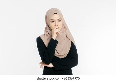 Portrait of a young Muslim woman dressed in office is thinking