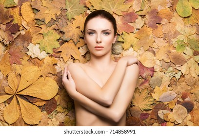 Portrait of young, natural and healthy woman over autumn background. Healthcare, spa, makeup and face lifting concept.