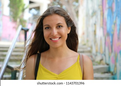 Portrait of young natural urban woman walking in Lisbon, Portugal