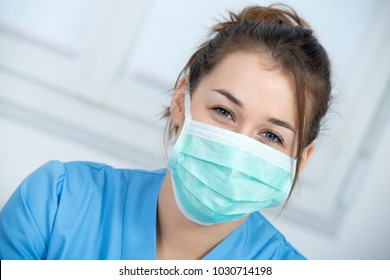 portrait of a young nurse with a mask