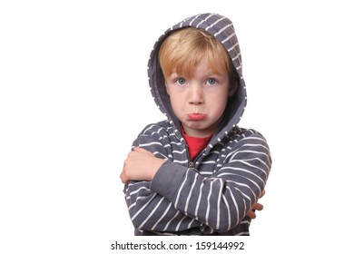 Portrait of a young offended boy on white Background