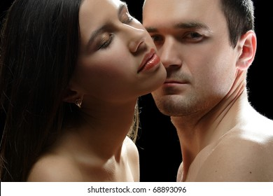 portrait of young people in love on a black background