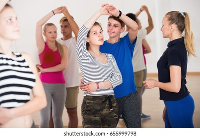 Portrait of young people  studying of partner dance  at dance school