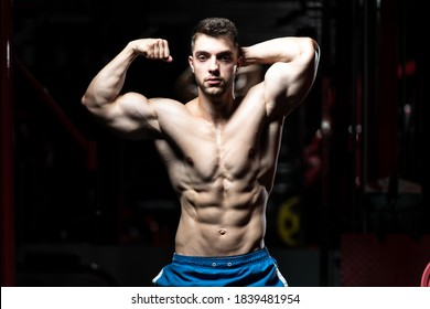 Portrait Of A Young Physically Fit Man Showing His Well Trained Body - Muscular Athletic Bodybuilder Fitness Model Posing After Exercises