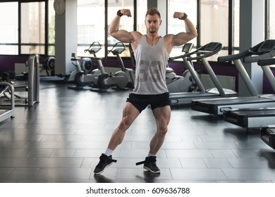 Portrait Of A Young Physically Fit Man In Undershirt Showing His Well Trained Body - Muscular Athletic Bodybuilder Fitness Model Posing After Exercises