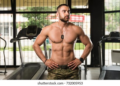 Portrait Of A Young Physically Fit Man Showing His Well Trained Body In Army Pants - Muscular Athletic Bodybuilder Fitness Model Posing After Exercises