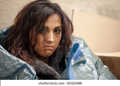 portrait of young poor woman in cold weather