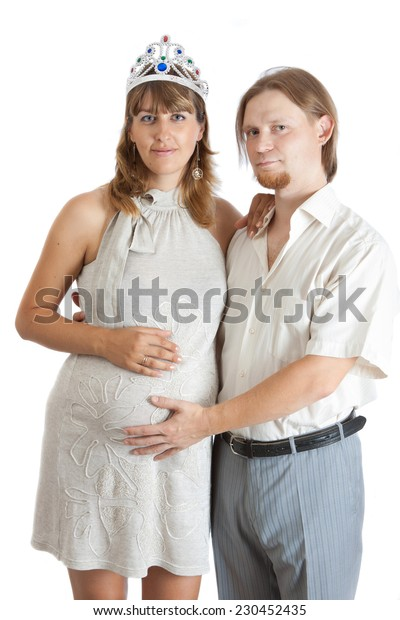 Portrait of a young pregnant woman with her happy boyfriend