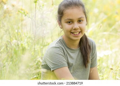 Portrait of young preteen girl in nature