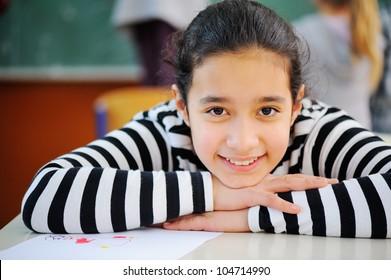 Portrait of a young pretty arabic schoolgirl