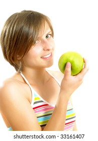 Portrait of a young pretty Caucasian blond woman with a nice colorful striped dress who is smiling and she is holding a green apple in her hand. Isolated on white.