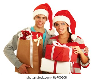 Portrait of young pretty couple  ?olding big red box - christmas gift and looking at camera