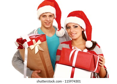 Portrait of young pretty couple holding big red box - christmas gift and looking at camera