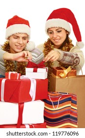 Portrait of young pretty couple holding big red box - christmas gift