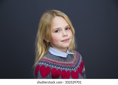 Portrait of a young pretty girl with blonde hair